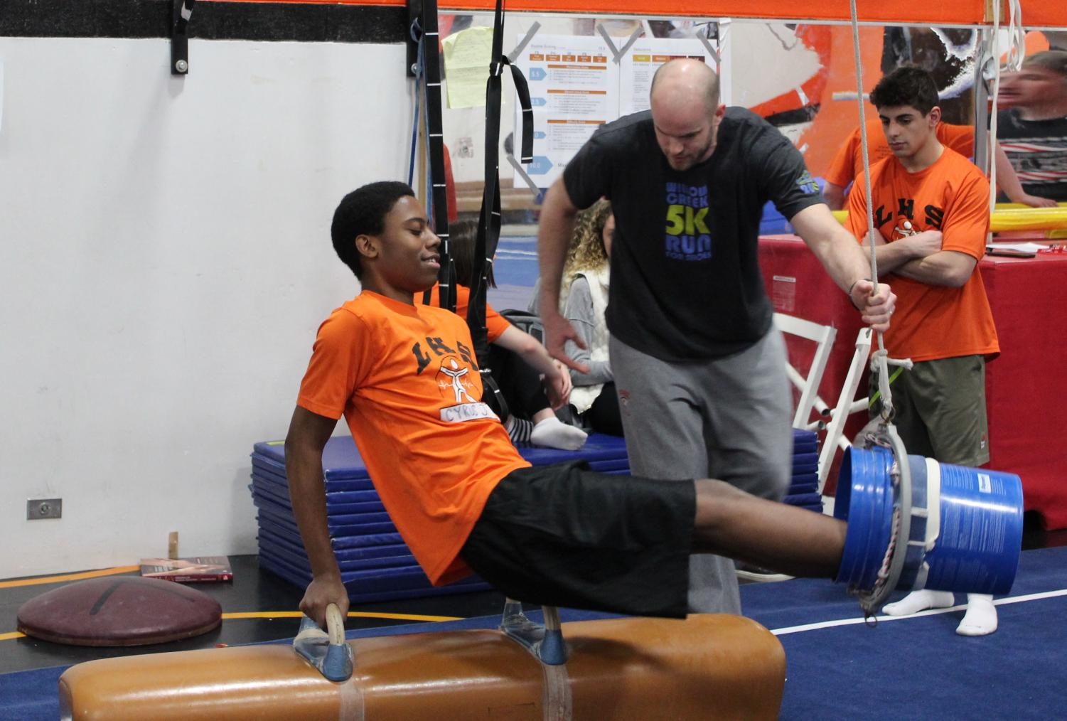 Cyrus Johnson participates in the gymnastics unit of Mr. Adam Stuart's sophomore P.E. class. Next year, some sophomore P.E. classes will separate boys and girls during a small unit on self-defense training for girls.