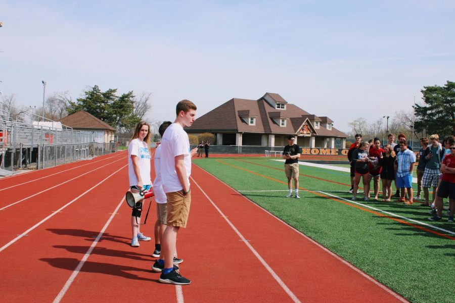 Sophomore Christian Voelker, junior Kylee Kraus and junior Ben Kanches stood on the track as they expressed their thoughts on the 2nd Amendment to a group of supporters on the football field.