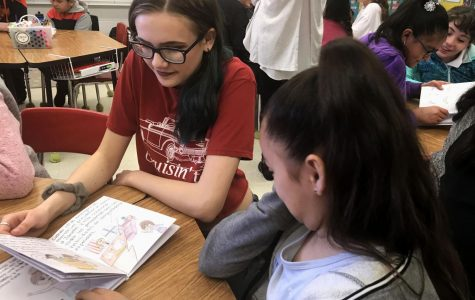 Spanish class presents final books to elementary students