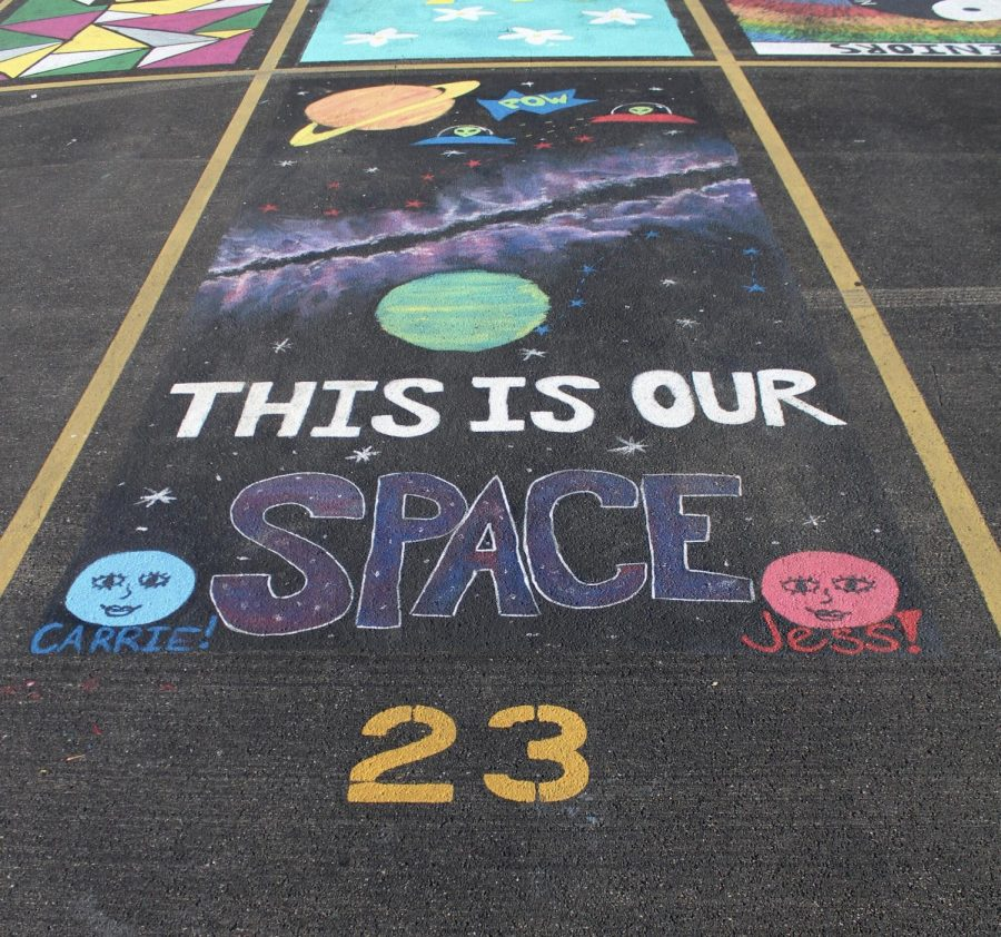 "Twisting the words of their parking ""space,"" seniors Carrie Jeffrey and Jess McLennan created a different dimension in their spot."