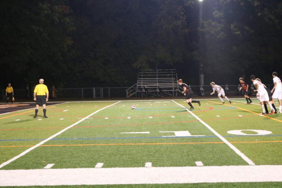 Senior+Evan+Rasmussen+lines+up+to+take+a+penalty+kick.