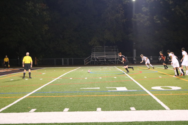 Senior Evan Rasmussen lines up to take a penalty kick.