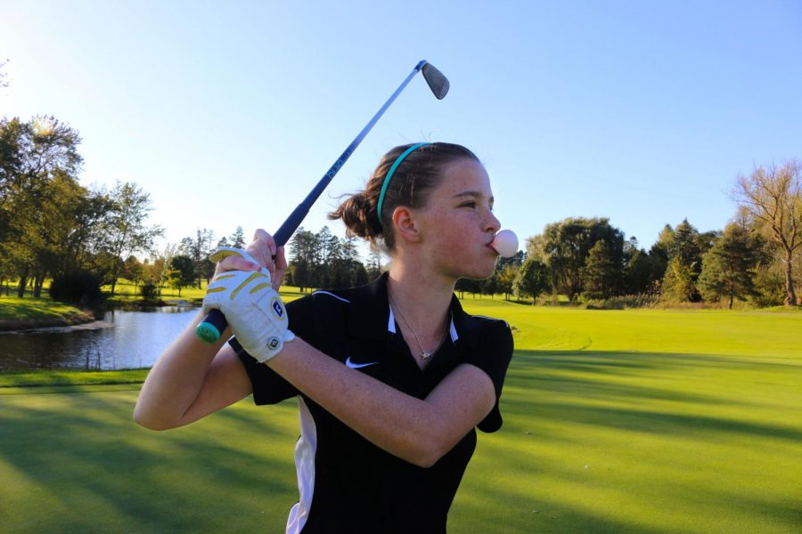 Payton DeBruler, a junior on the LHS Varsity golf team, has recently began the habit of chewing gum while she is playing.