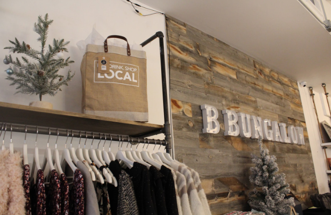 """A local shop called B Bungalow was decorated with bags supporting the shop local day. The bags had different sayings written on them: """"Live. Love. Local"""" and """"Eat. Drink. Shop. Local."""""""