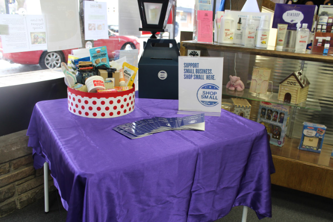 Free passports were given out to the shoppers to be stamped by each shop that they visited. They could then submit their passports into a raffle of the shop of their choosing. Petranek's Pharmacy set up a small table near the entrance to display their raffle basket.