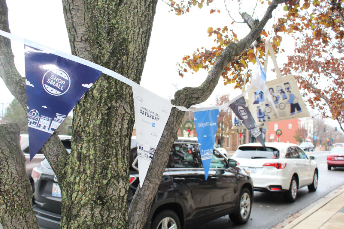 Some stores in downtown Libertyville that participated in Small Business Saturday promoted it by putting flags and bags with the logo on the trees in front of their shops.