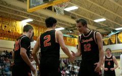 Boys basketball gains first win over Carmel, 57-46
