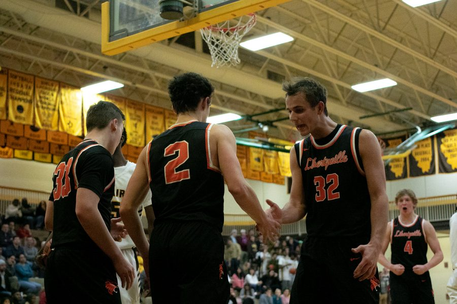 Drawing a clutch foul after a two-point layup late in the game, Wilterdink (2) had his teammates hyped up.