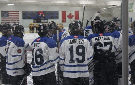 The Icecats gather before the game and have a brief talk.