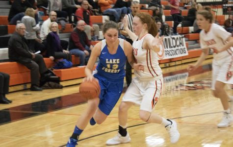 Finola Summerville (13) drives to the basket while Lydia Crow (50) plays tight defense on her.