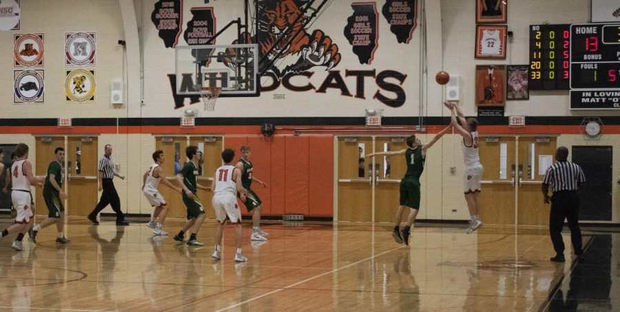 Junior Jackson Watson attempts a three-point shot in the first quarter.