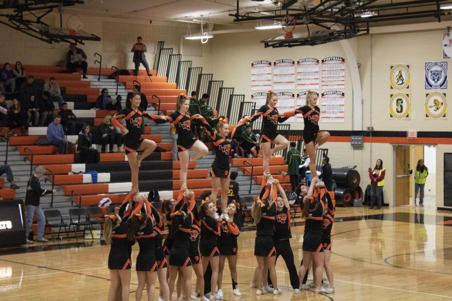 The LHS cheerleaders perform a brief routine at halftime for the crowd.