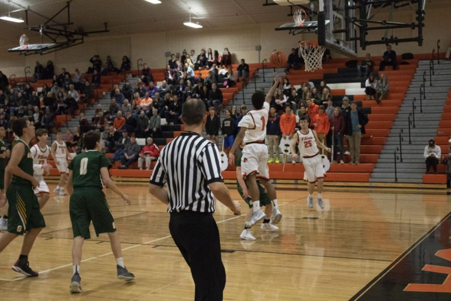 Senior Dominic Quigley makes a layup at the very end of the game, further securing the win for LHS.