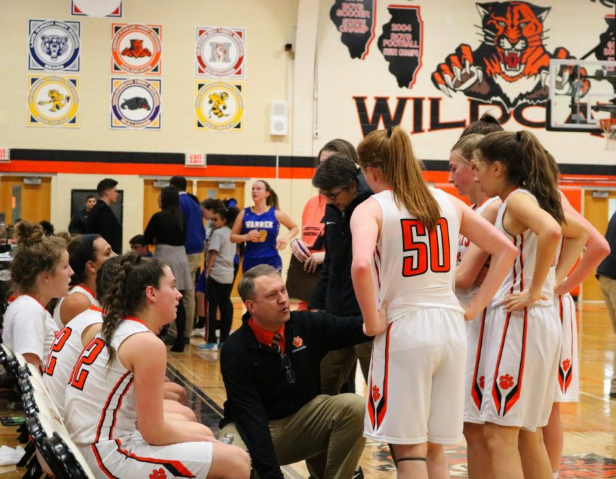 Coach, Greg Pedersen gives the team a talk during a time-out called by LHS.