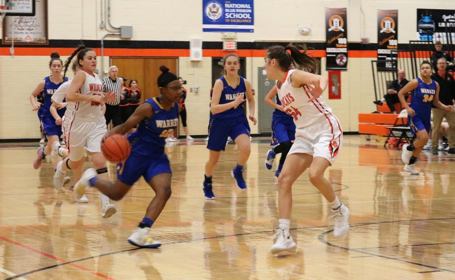 #54, junior Abby Parkerson faces off with the score 35-45 Libertyville.