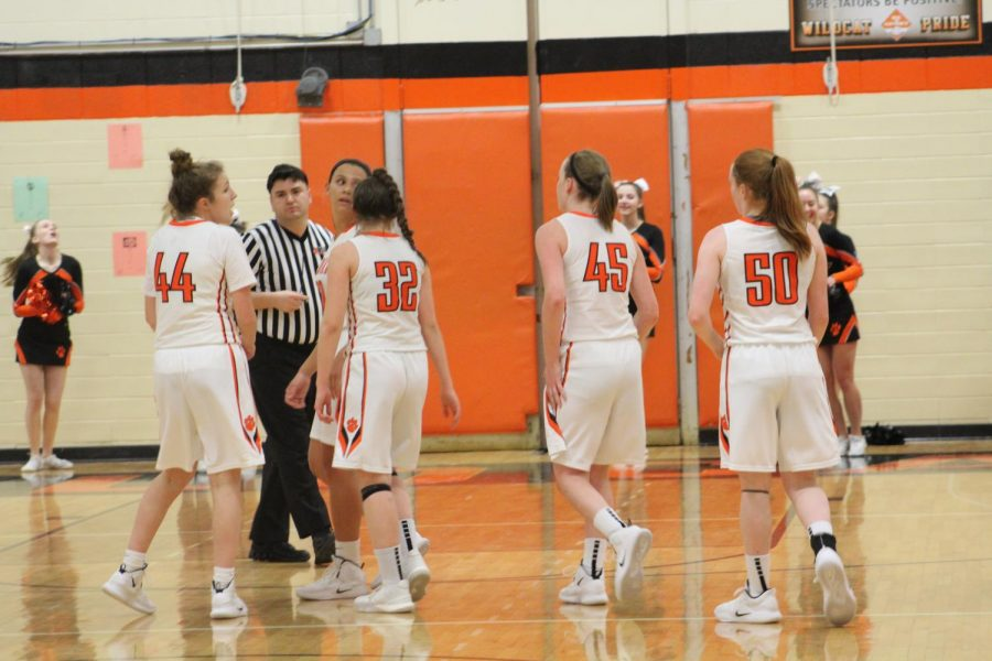 Wildcats Lauren Huber, Madeline Spaulding, Margaret Buchert, Abigail Frea, and Lydia Crow wait for the second half tip-off.