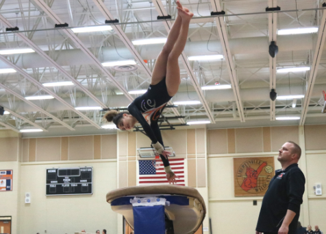 Freshman Rachel Bertsch leaps onto the vault and, using her hands, springs herself up to land perfectly on the mat.
