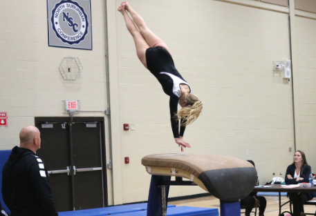 Senior Kylie Skie lands her second jump off the vault.