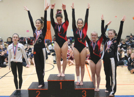 Bertsch (second from the left) and sophomore Skyler Allen (far right) received second and fifth-place medals, respectively, for the JV vault.
