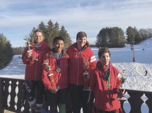 Kraus (far left) and some of her Wilmot teammates received awards after the last race of the year at Tyrol Basin in Wisconsin. They were awarded trophies for qualifying as overall point winners throughout the 2018 season.