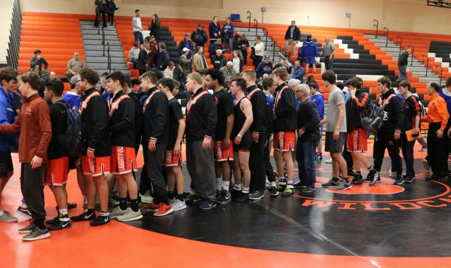 Both teams shake hands after the meet ended with a score of 47-15 in Libertyville's favor.