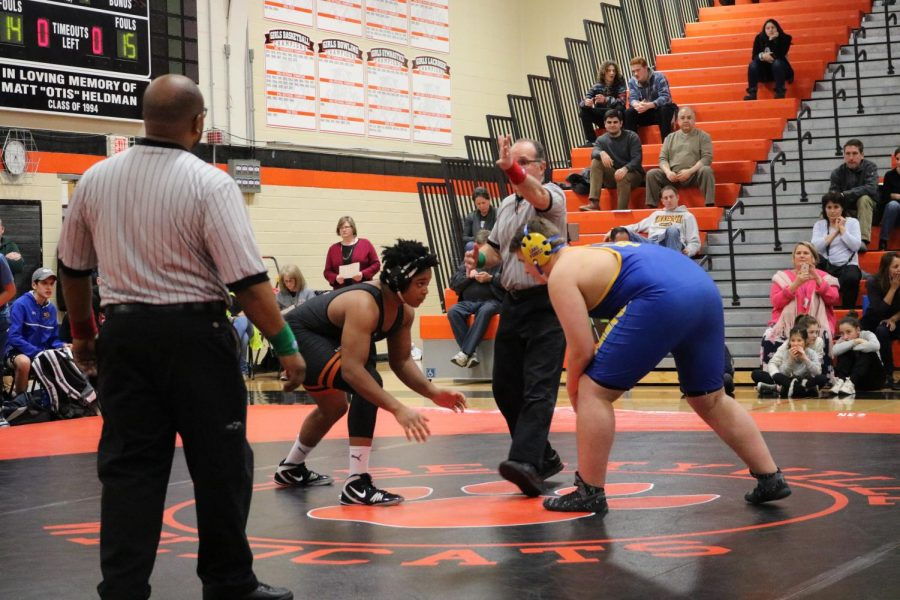 Junior Jordan Smith squares off against his opponent at the start of his match.