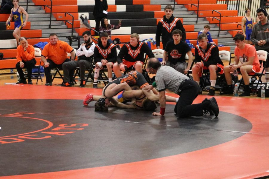 Freshman Michael Rocco attempts to pin the Lake Forest wrestler to the mat. He would later win his match.