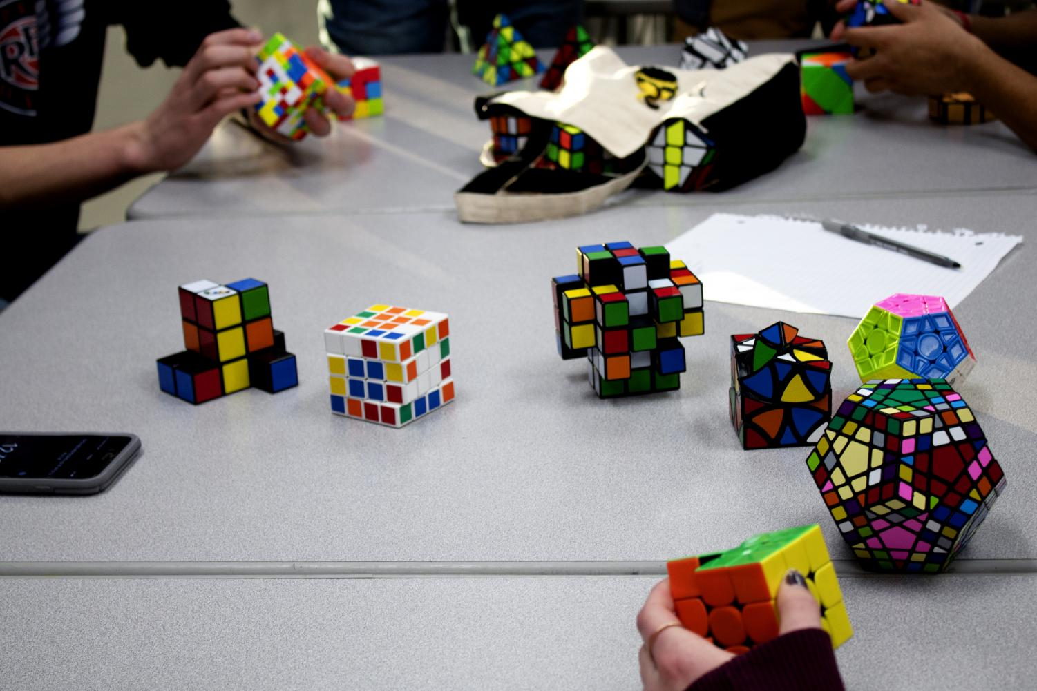 Members of Cubing Cats bring their own Rubik's Cube collections to every meeting to share their cubes with people and experience solving different types of cubes.
