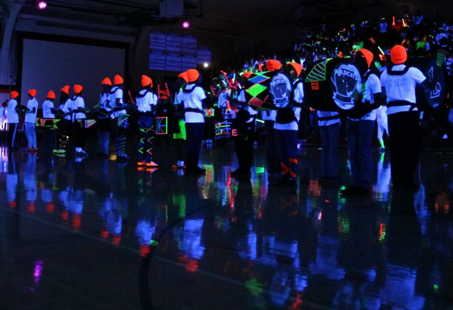 A neon-decked drumline performed to rally the students after the cheer team's routine.