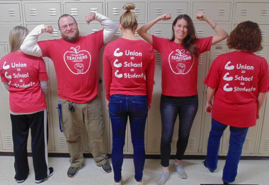 Ms.+Dana+Brady%2C+the+building+representative+of+the+teacher%27s+union+%28and+second+from+the+right%29%2C+poses+with+fellow+teachers+in+their+red+shirts.