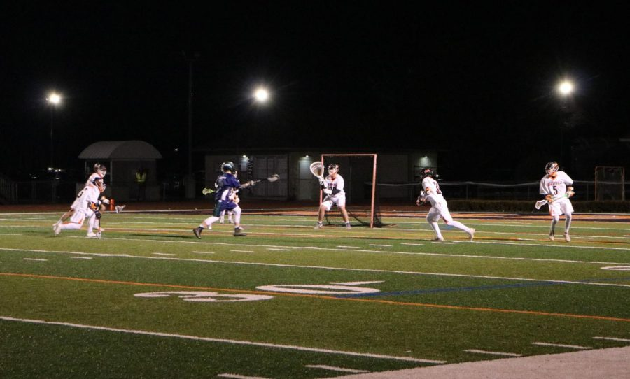 Wesley Hare readies to block a shot at the goal from Bartlett.