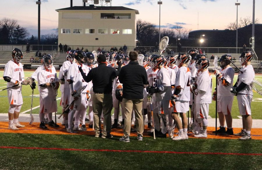 Head coach Brady Sullivan gives words of encouragement to the players during the first quarter.