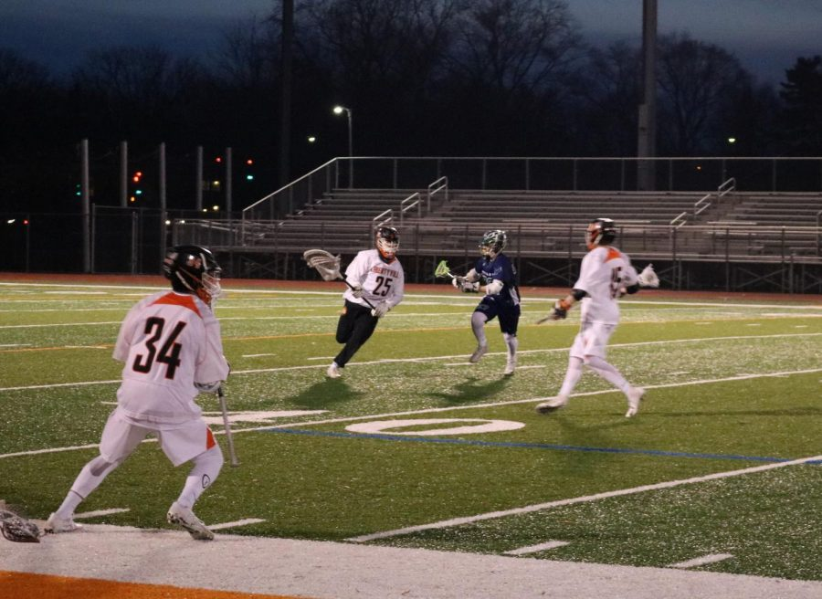 Senior Matthew Wagner (25) returns the ball to his teammates after blocking a shot by Bartlett.