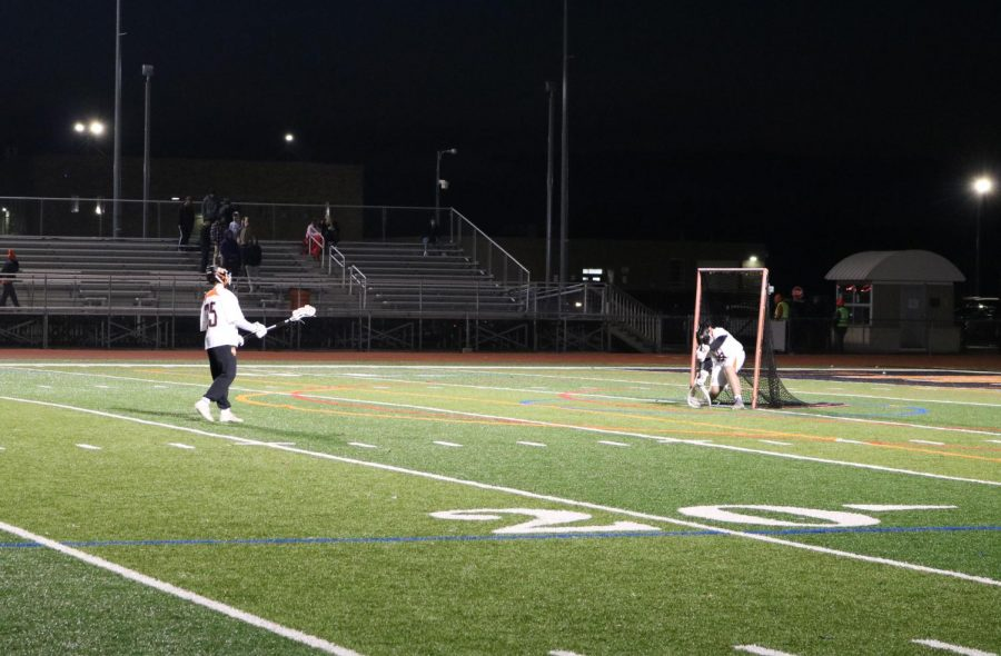 Wagner and junior Wesley Hare, the goalies for the varsity team, practice blocking shots during halftime.