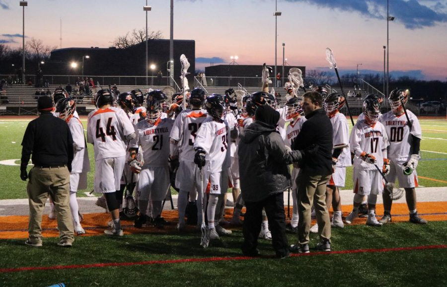 The team breaks their huddle after Coach Sullivan gives them advice during the first quarter.