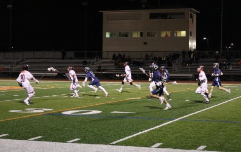 The LHS team sprints toward the goal after stealing the ball from Bartlett.