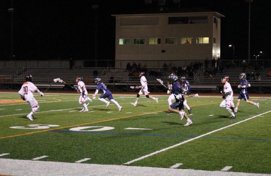 The LHS team sprints toward the goal after stealing the ball from Bartlett.