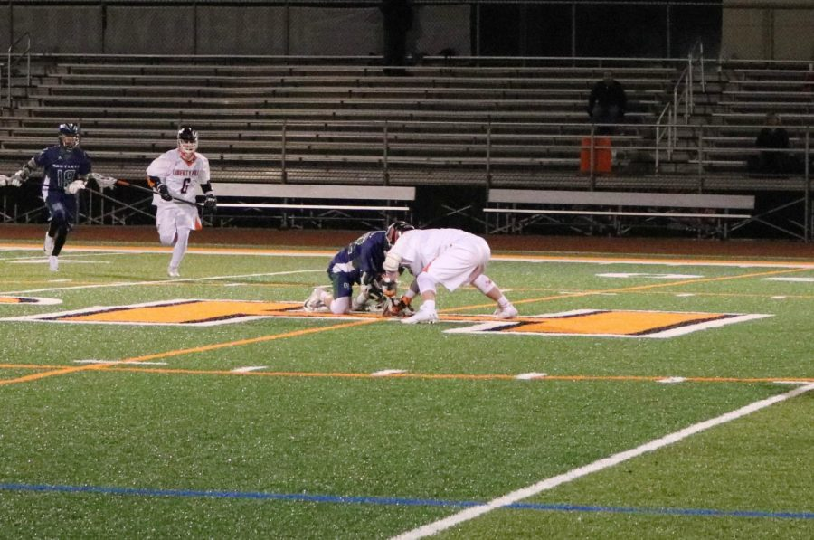 On the faceoff, one player from each team attempts to wrestle the ball from the other's grasp after a goal was scored.