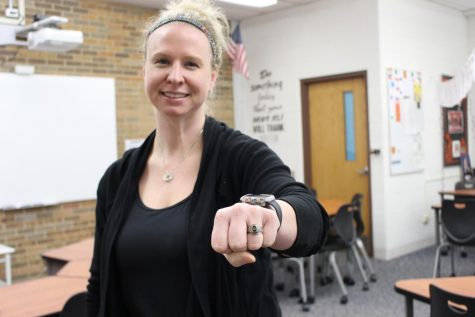 Mrs. Amann holds out her state ring from when she won the championship during her years of high school soccer.