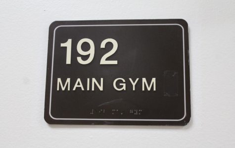 While the main gym was closed there were warning signs on all of the gym doors as well as wrestling mats in front of the doors to block the entrances.