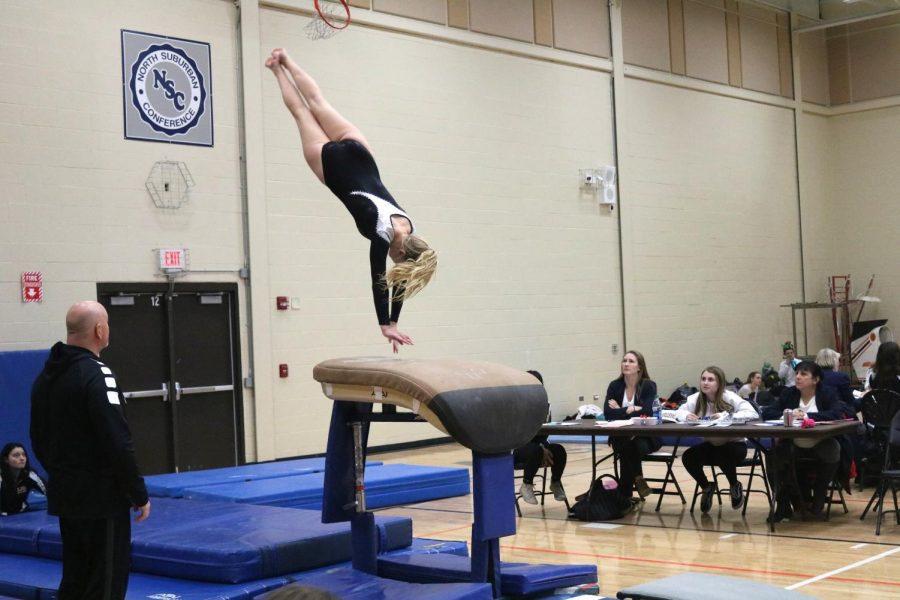 Senior Kylie Ski prepares to land a vault at a girls gymnastics meet.