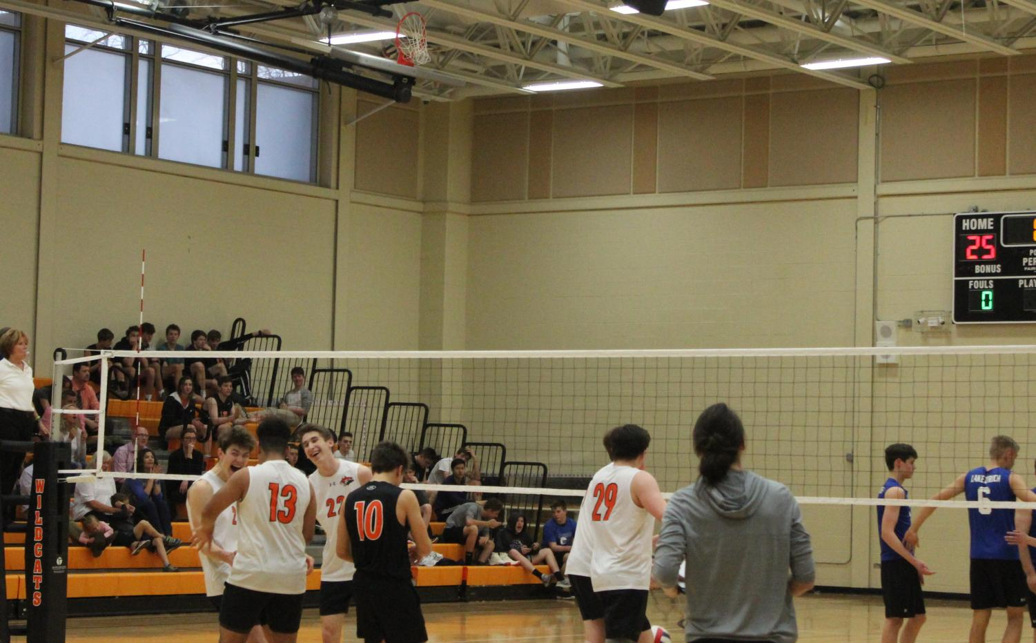 he+Wildcats+celebrate+after+securing+a+tight+first-set+victory.%0A
