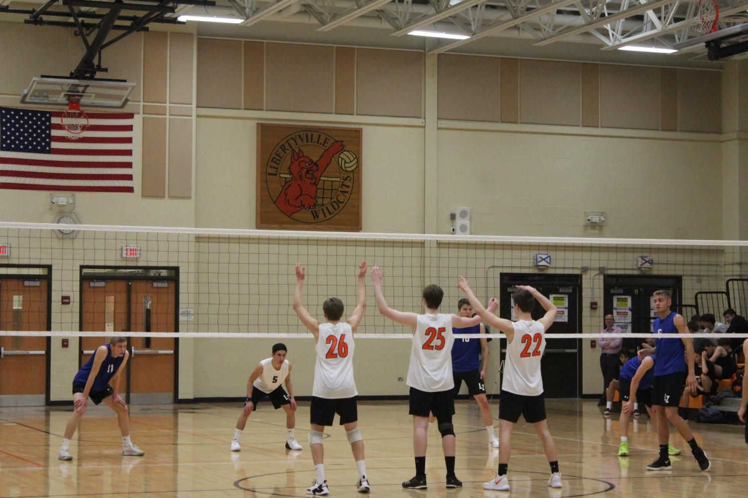 Chris+Mack%2C+Brendan+Duffy%2C+and+Weick+get+set+as+their+teammate+prepares+to+serve.%0A