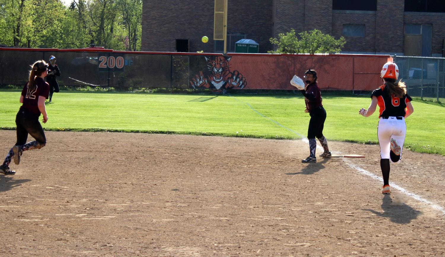 The+Zion+Benton+Zee-Bees+ended+the+third+inning+by+throwing+out+Katie+Jahncke+at+first+base.+