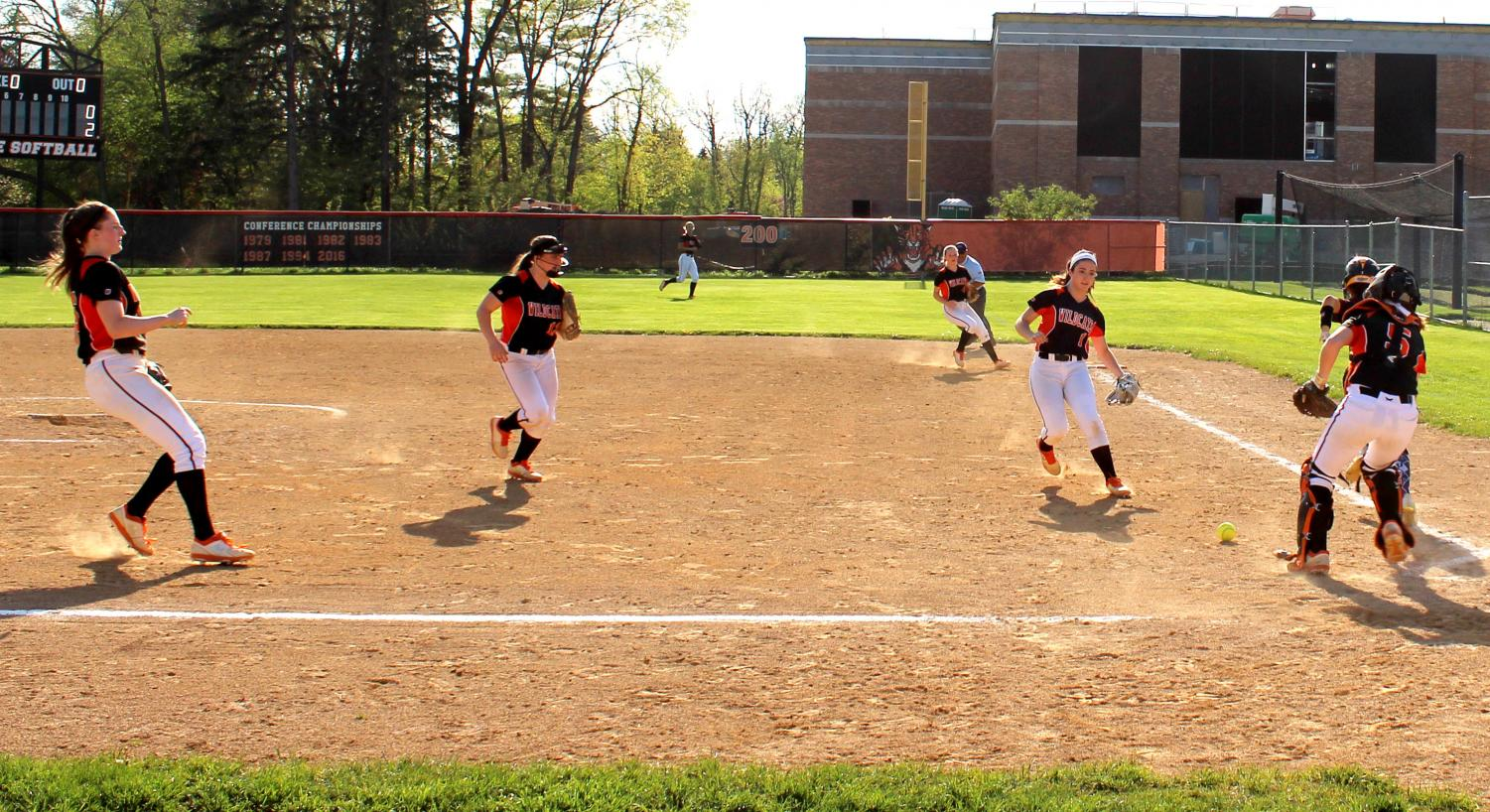 The+Cats+work+together+and+communicate+after+a+bunt+by+Zion-Benton%3B+Libertyville+recorded+the+out.