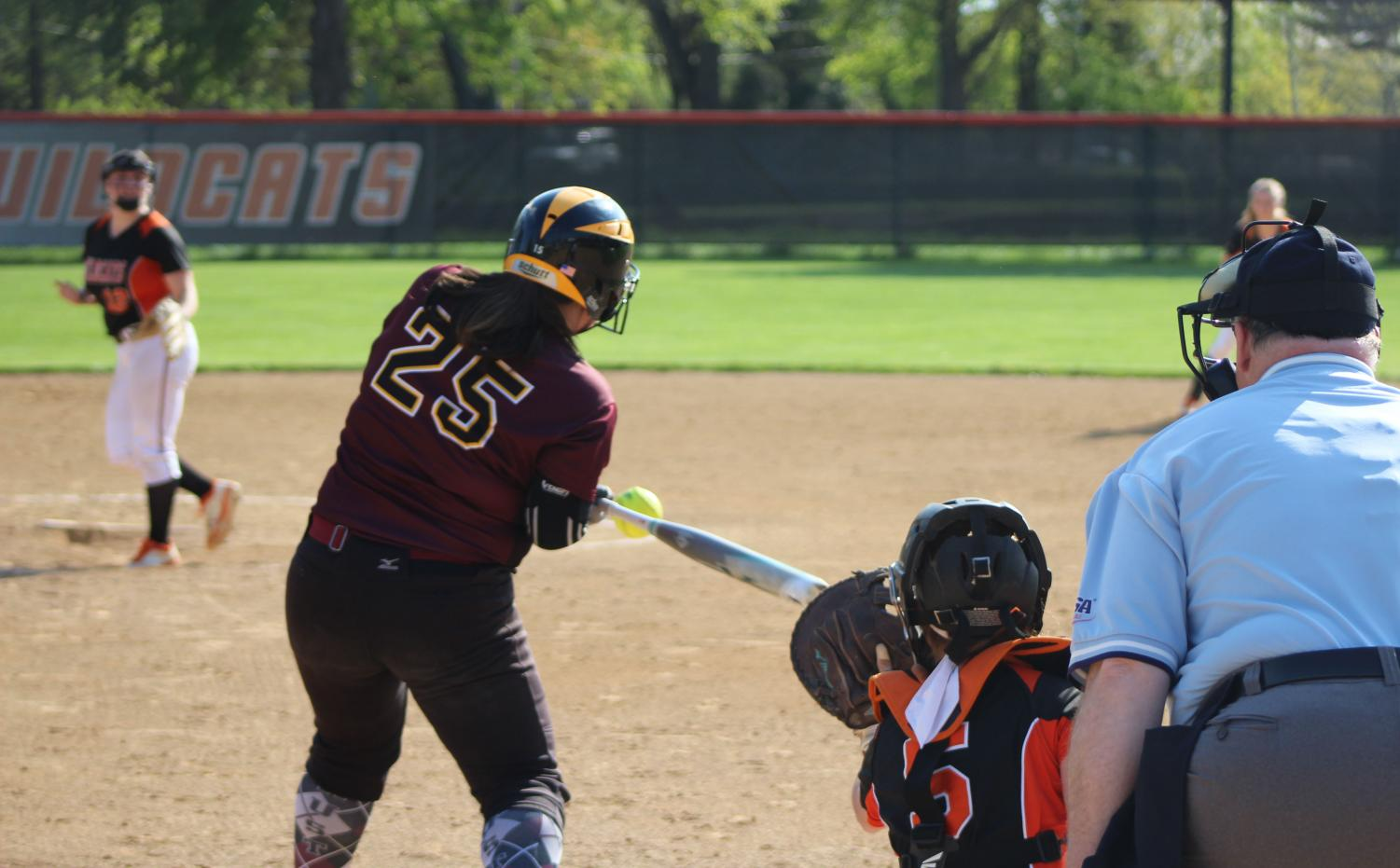Senior+pitcher+Amanda+Page+pitches+the+ball+to+Zion%E2%80%99s+first+baseman%2C+Jenna+Villalobos%2C+who+got+a+hit+in+this+at+bat.+