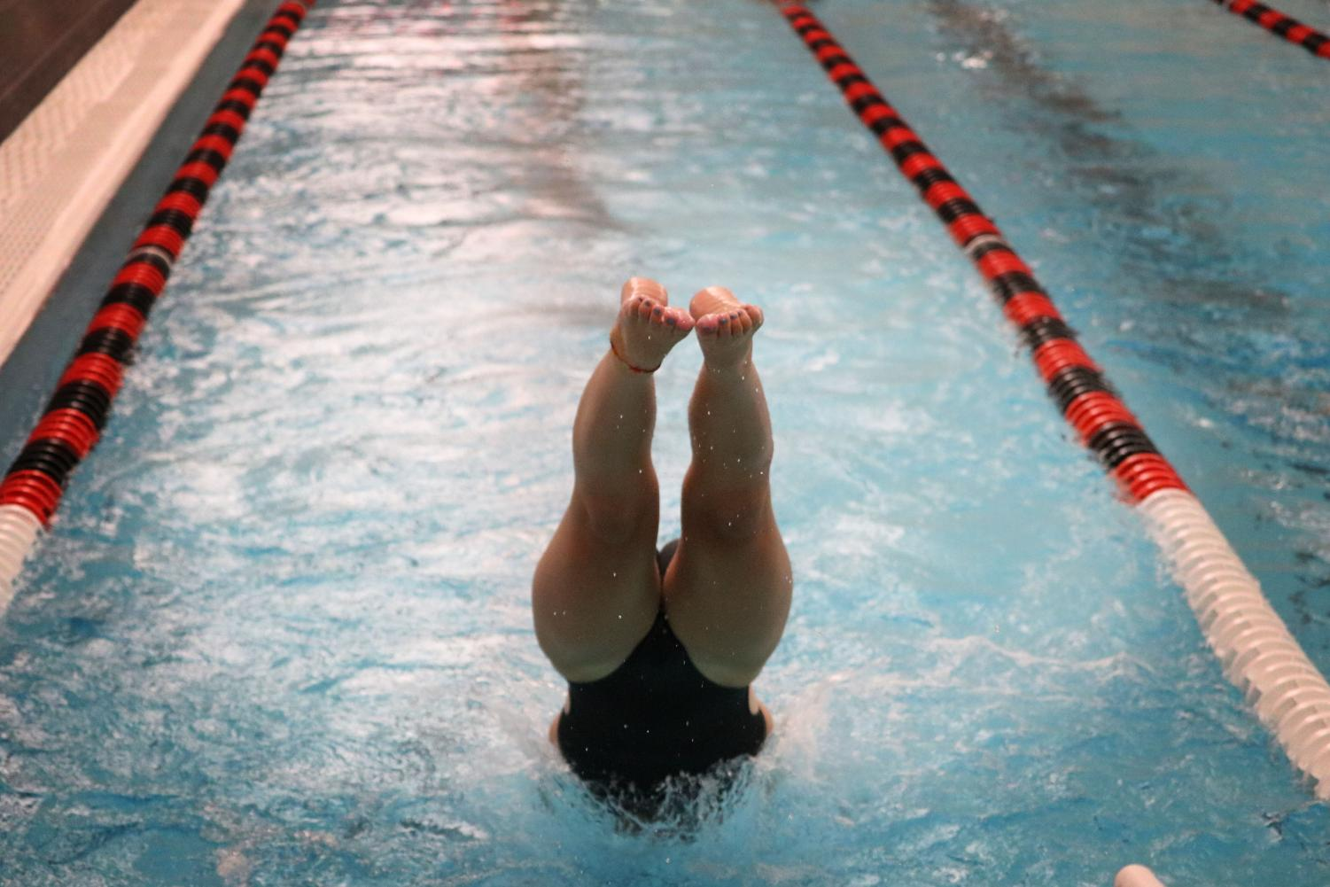 Girls swimming and diving competes in new pool, loses to Fremd