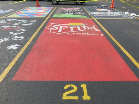 Seniors paint their carpool parking spaces