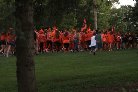 Students enter the North Shore bike path, following the cheerleaders and marching band.