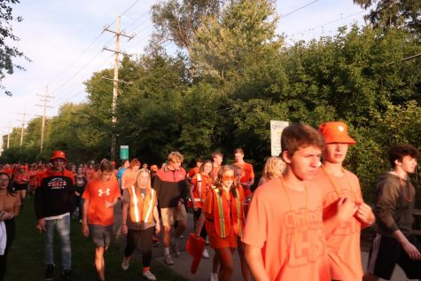 Many students wore the orange shirts and bucket hats they purchased from spirit pack sales.